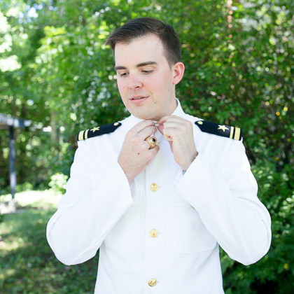 Jeff and Emily Mitchell Robert E. Lee Hotel groom buttoning uniform