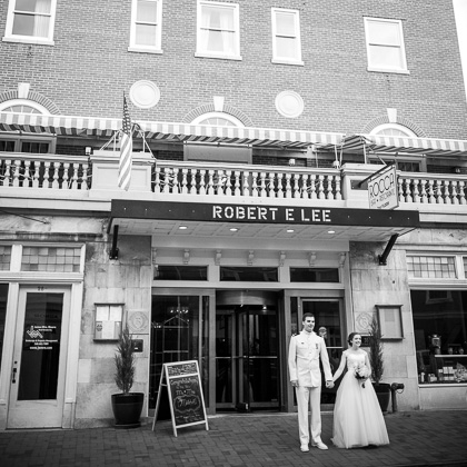 Jeff and Emily Mitchell Robert E. Lee Hotel bride and groom in front of hotel